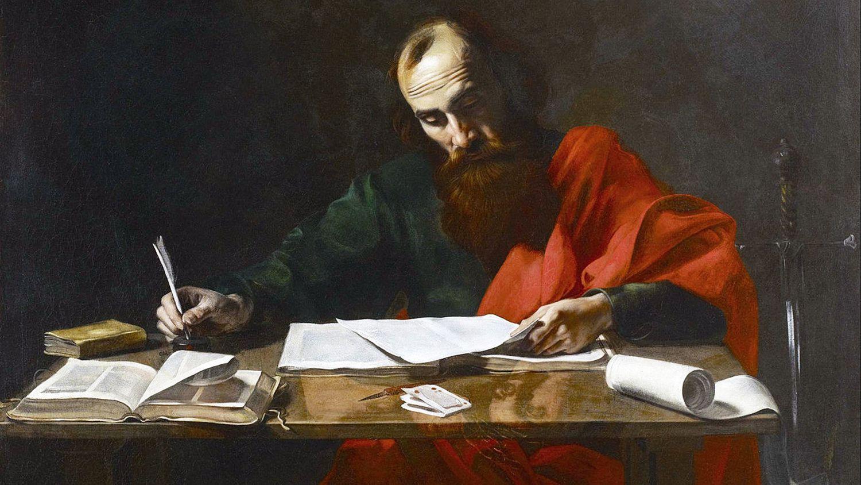 Apostle Paul writing in paper using pen